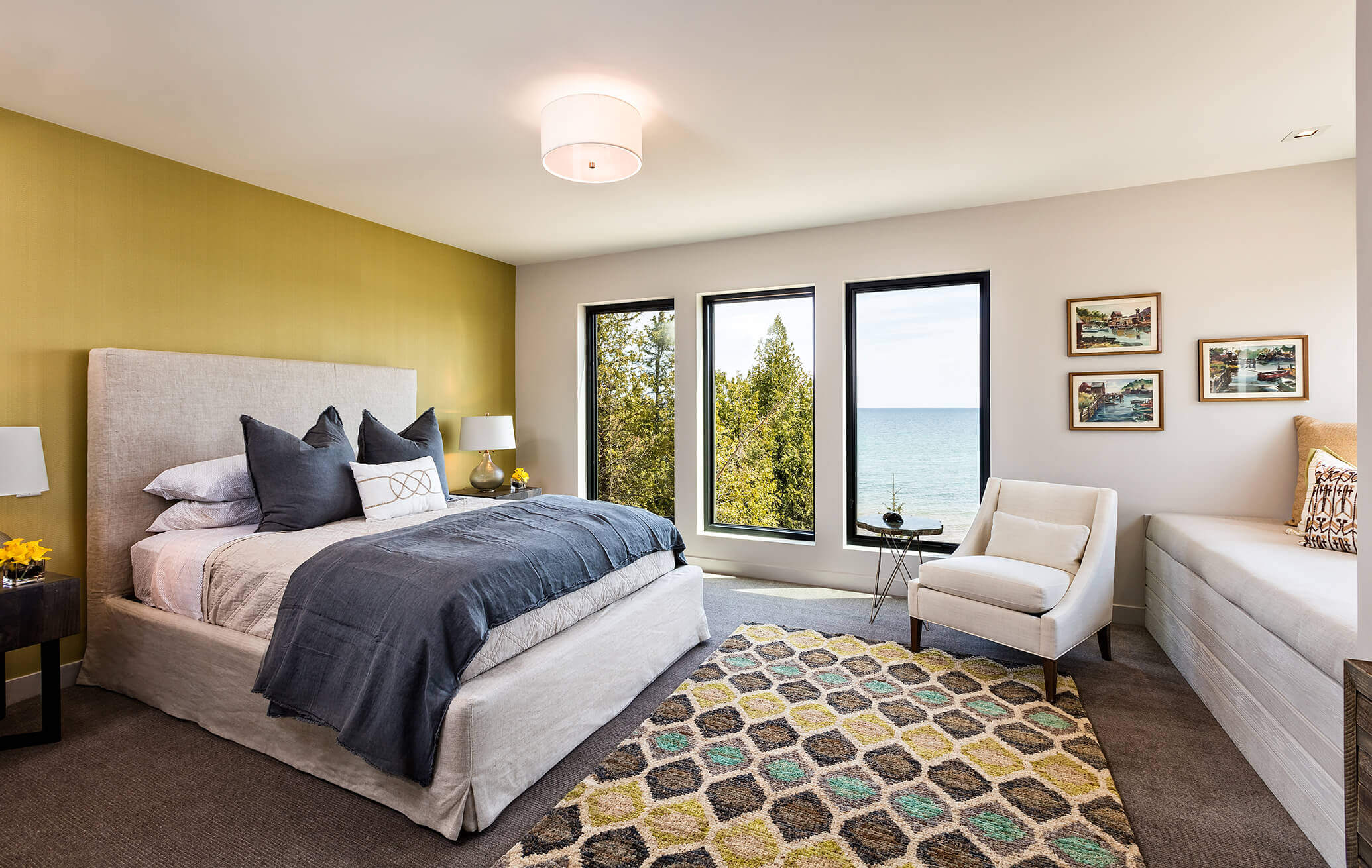 A bedroom featuring sleek window lines and a view of Lake Michigan.