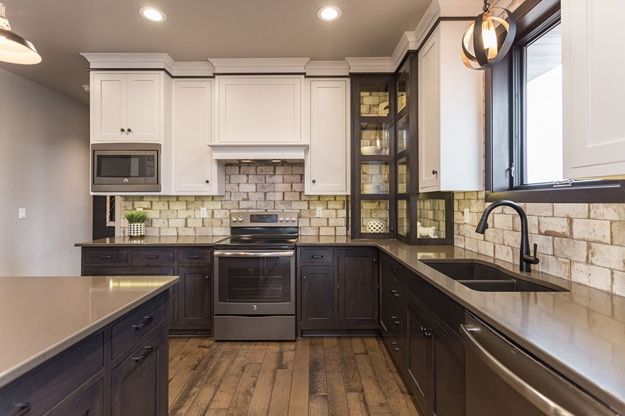 Kitchen With Rustic Brick Backsplash - Roc Building Solutions and Pella Windows