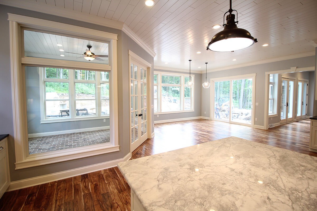 Royalty Custom Homes - Large kitchen with Pella windows and patio doors.