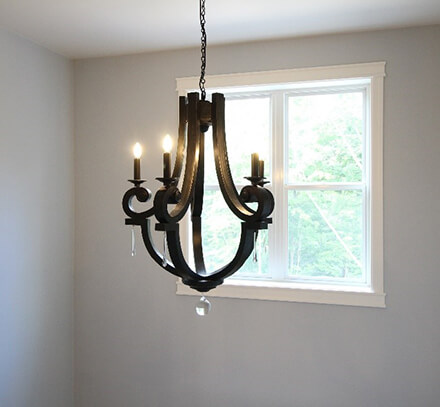 Royalty Custom Homes - Light Fixture with a Pella window in the background.
