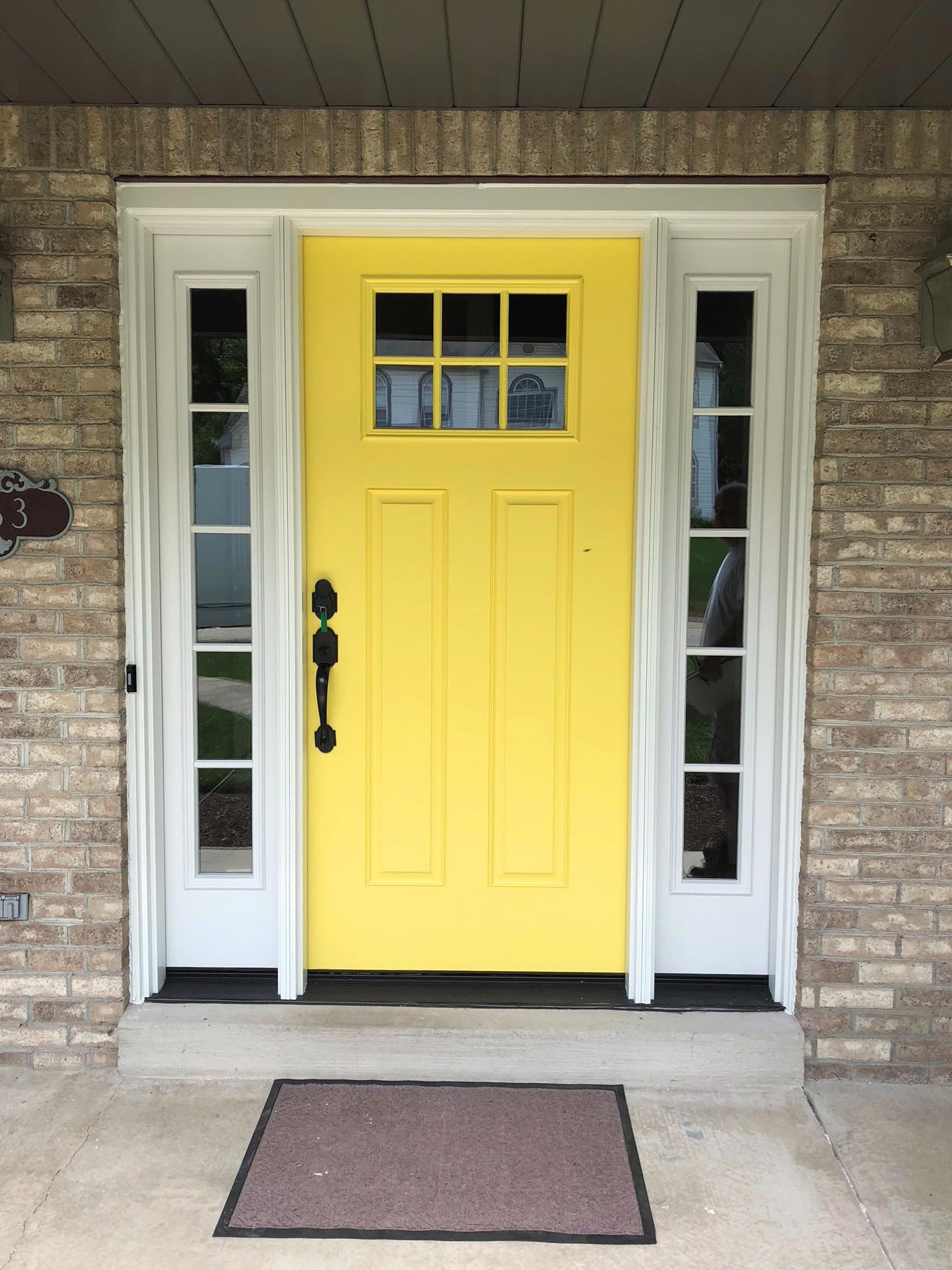 bright yellow Pella fiberglass door