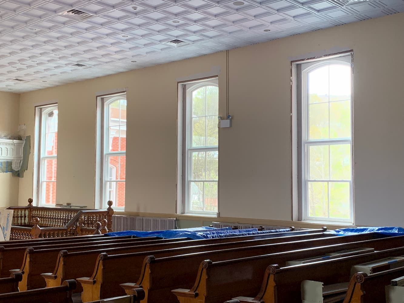 Interior view of courtroom in Wayne County Courthouse with all new wood windows from Pella