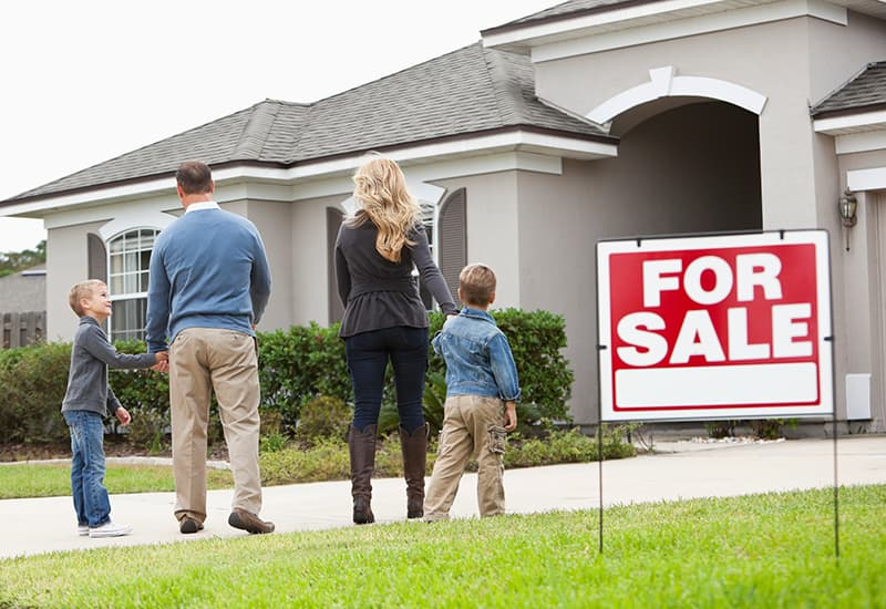 Family outside sold home exterior walking inside