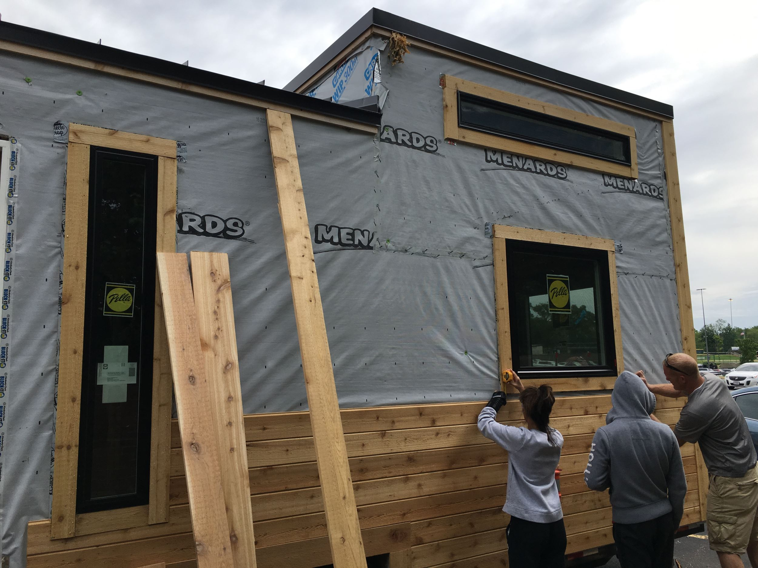 High school students building a tiny house as part of a class project