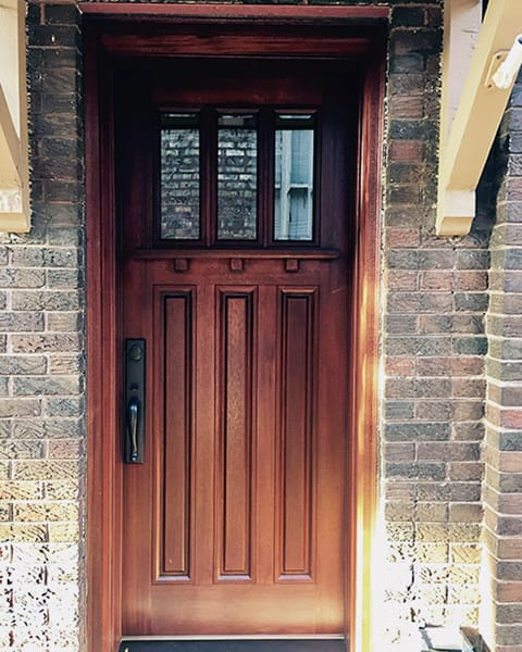 Craftsman Style Wood Entry Door With Brick Exterior