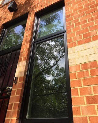 Black windows with red brick