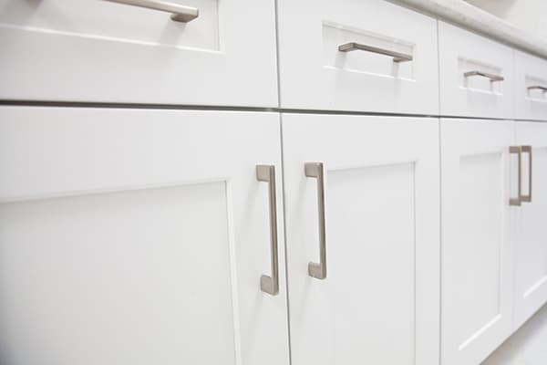 White shaker-style cabinets