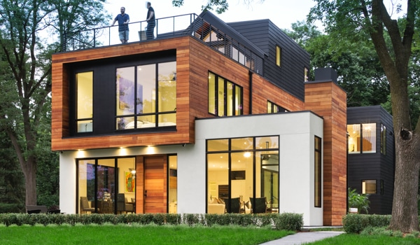 Modern home exterior with lots of floor-to-ceiling windows