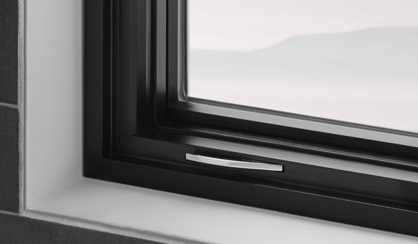 Casement window corner view with black interior trim and fold-away crank