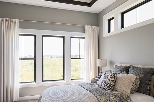 Black frame windows in bedroom