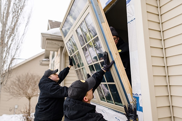 Pella installation team putting in new double window