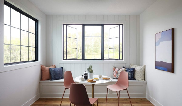 Combination of three ENERGY STAR windows with black frames and square grilles in breakfast nook