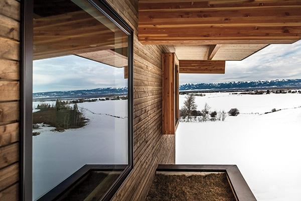 Exterior photo of windows on a cabin in winter