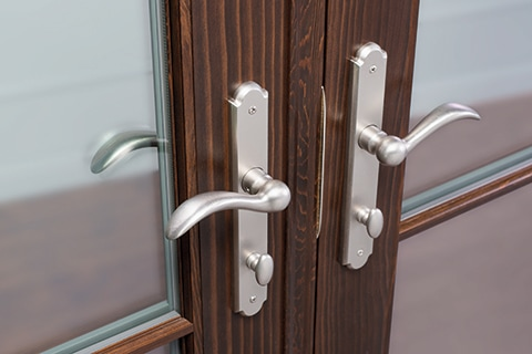 Multipoint lock hardware on wood French patio doors