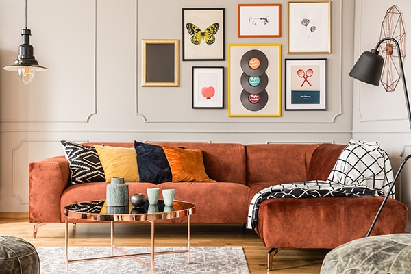Upholstered sofa with soft pillows reduces noise from wall in living room