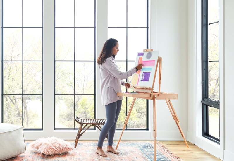 Woman painting in room with noise-reducing Lifestyle Series windows