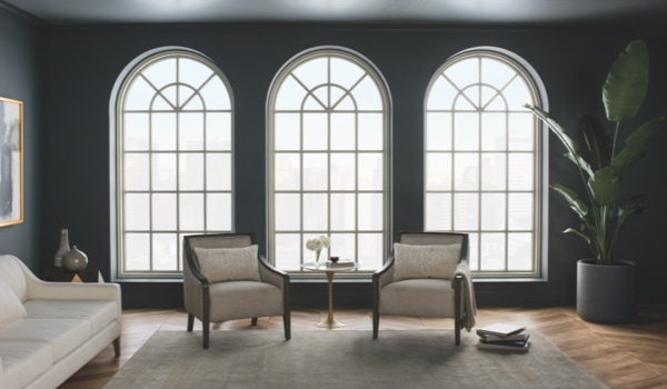Three tall arched windows in living room