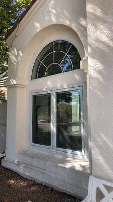 exterior view of wood casement windows with arched transom