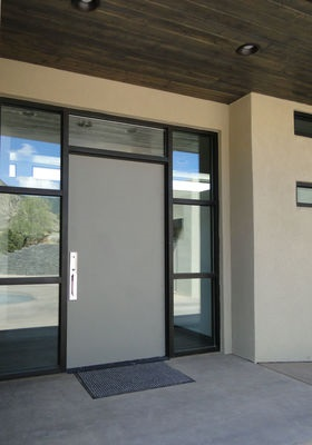 gray modern fiberglass entry door in Albuquerque desert