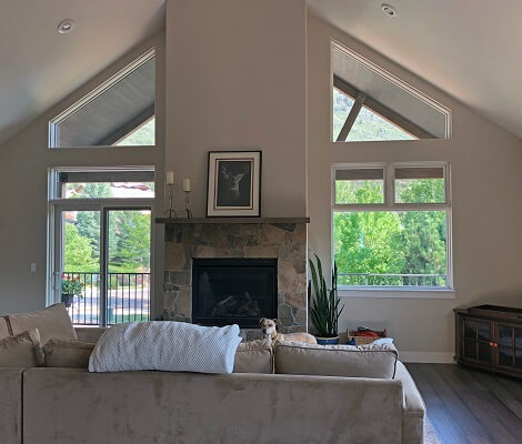 living room view of durango home with new wood special shape, casement and awning windows
