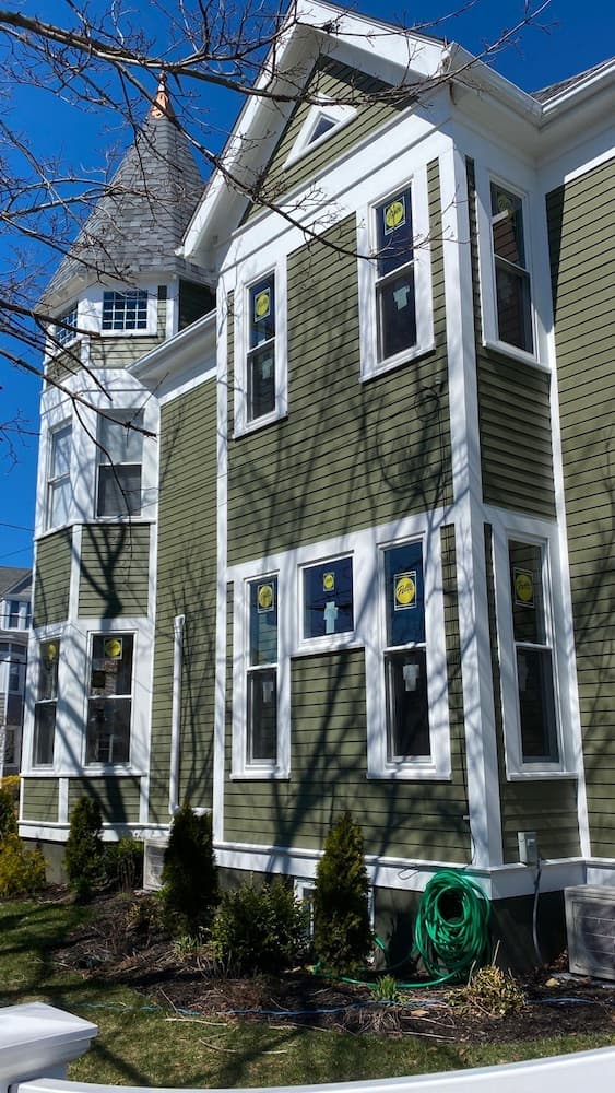 Exterior view of replacement double hung windows in Medford home