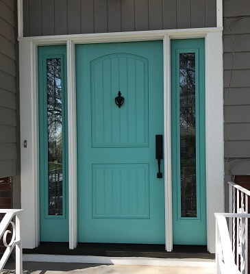 Fiberglass entry door with decorative glass