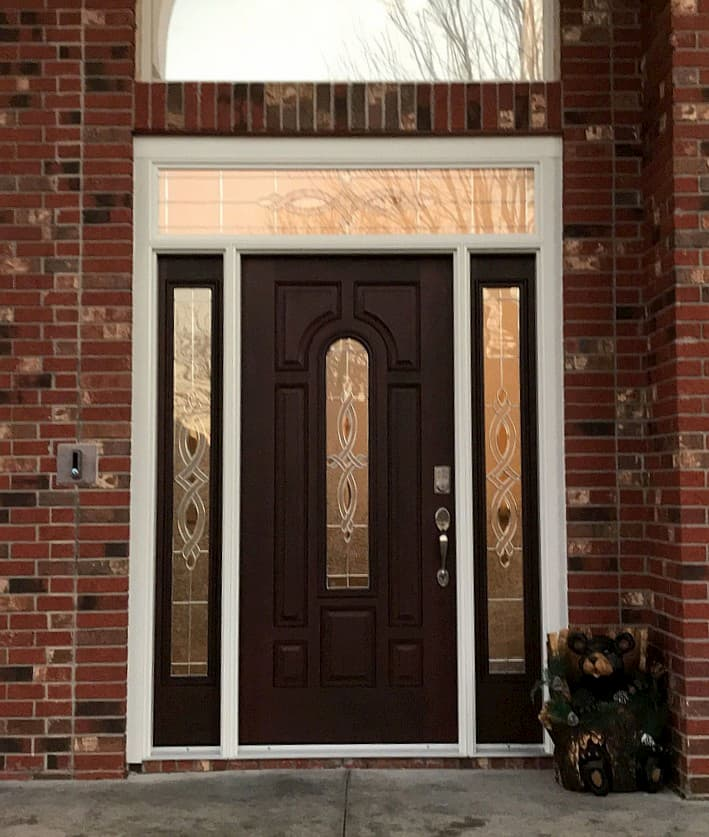 New wood entry door with sidelights and a transom window