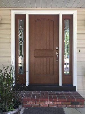 new fiberglass entry door with decorative side lights