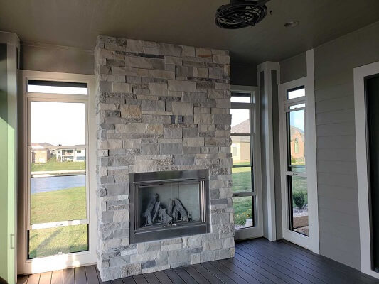 after fireplace image of omaha home with new multi slide patio door