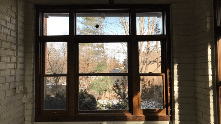 wood picture window featuring single-hung and fixed windows