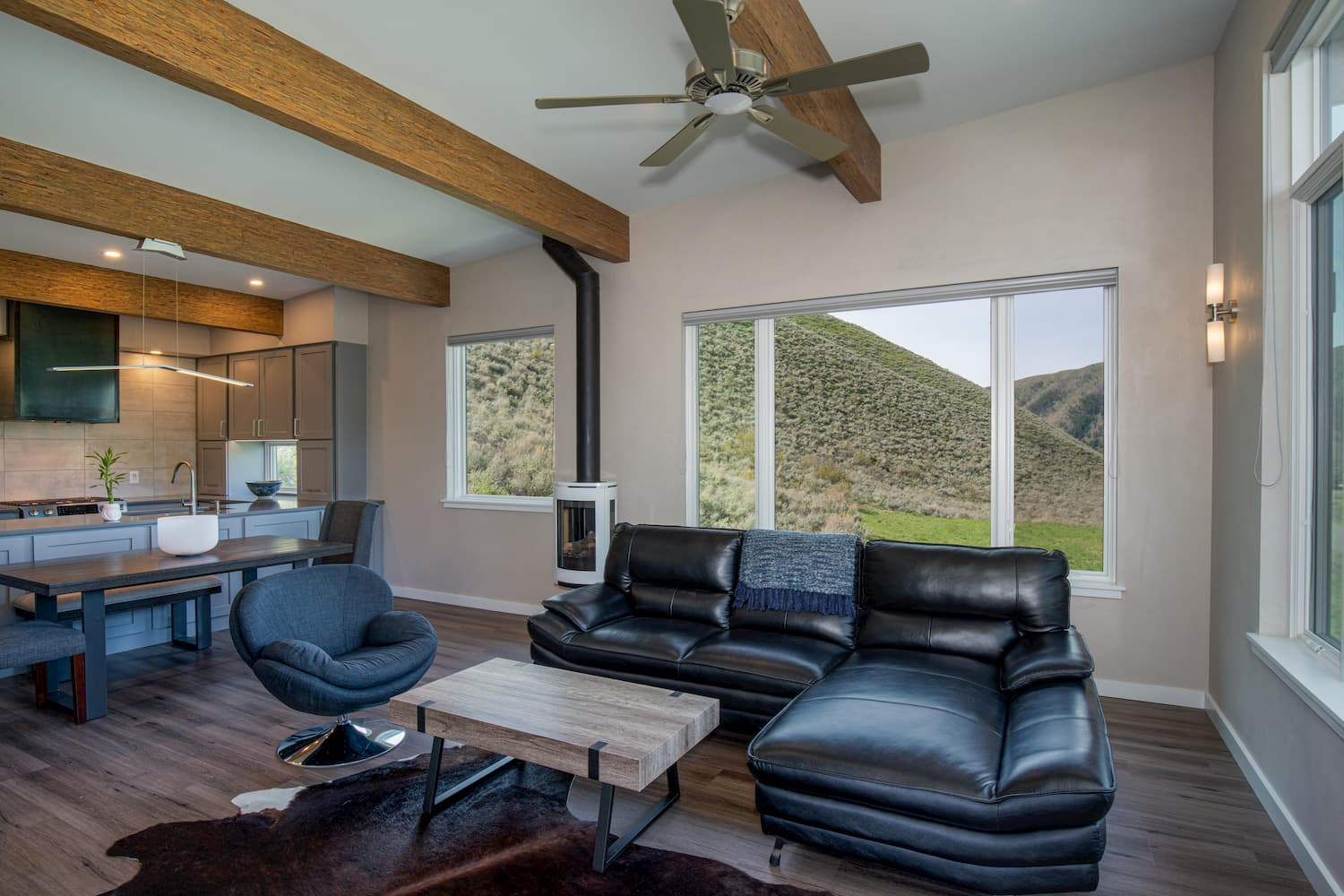 Hailey home living room entertaining area with beautiful hillside view through Pella windows