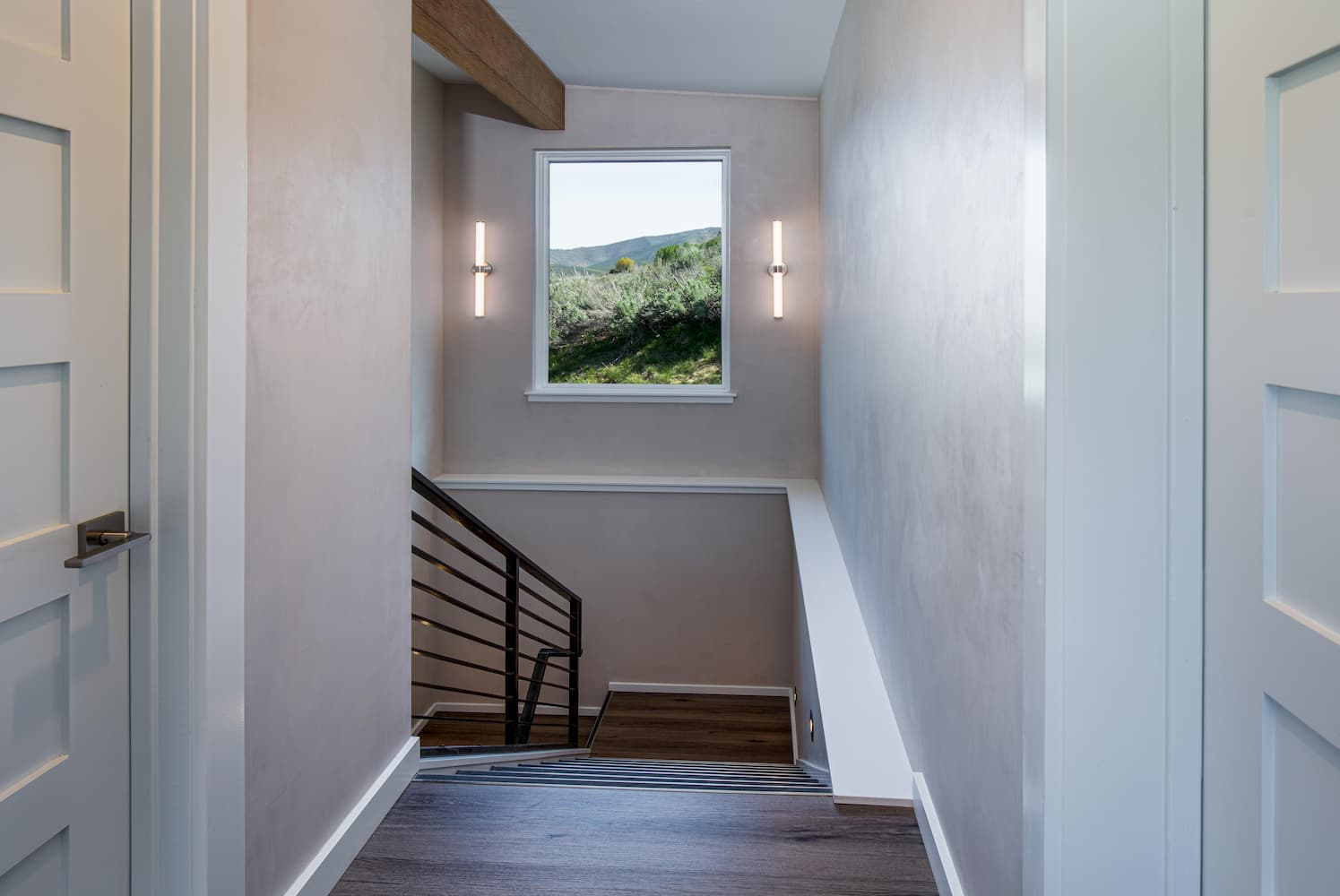 Hallway inside Hailey home with Pella window above the stairwell