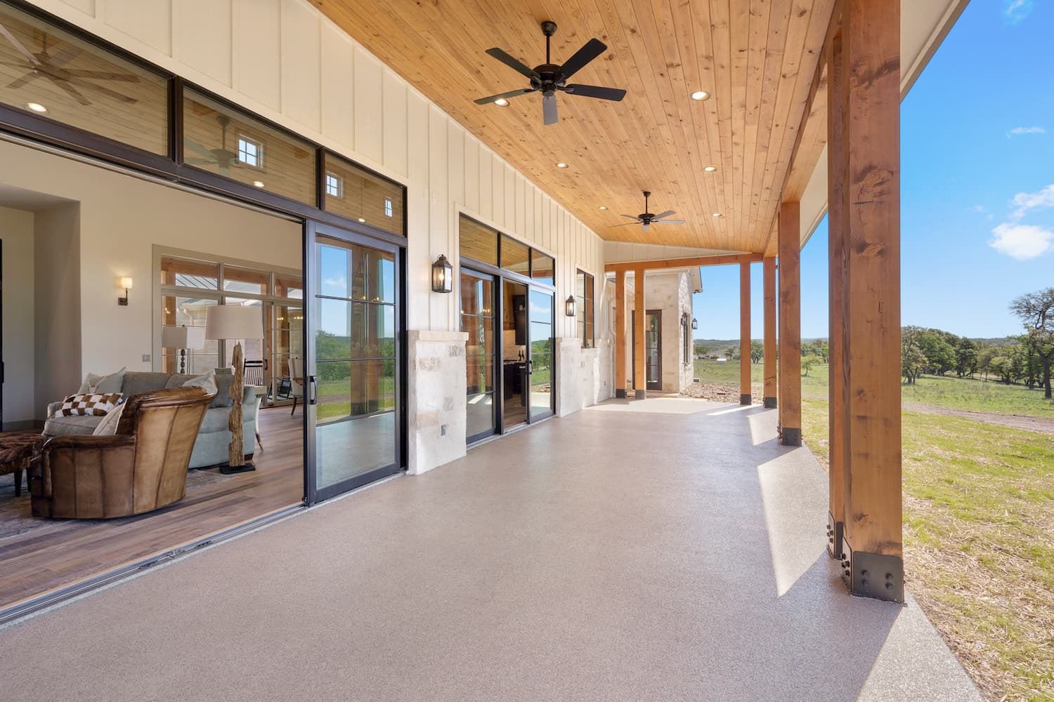 Rear view of Texas farmhouse style home with sliding glass doors