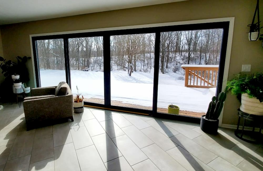 Black Sliding Patio Doors Open Up Ada Living Room Pella Of Western Michigan