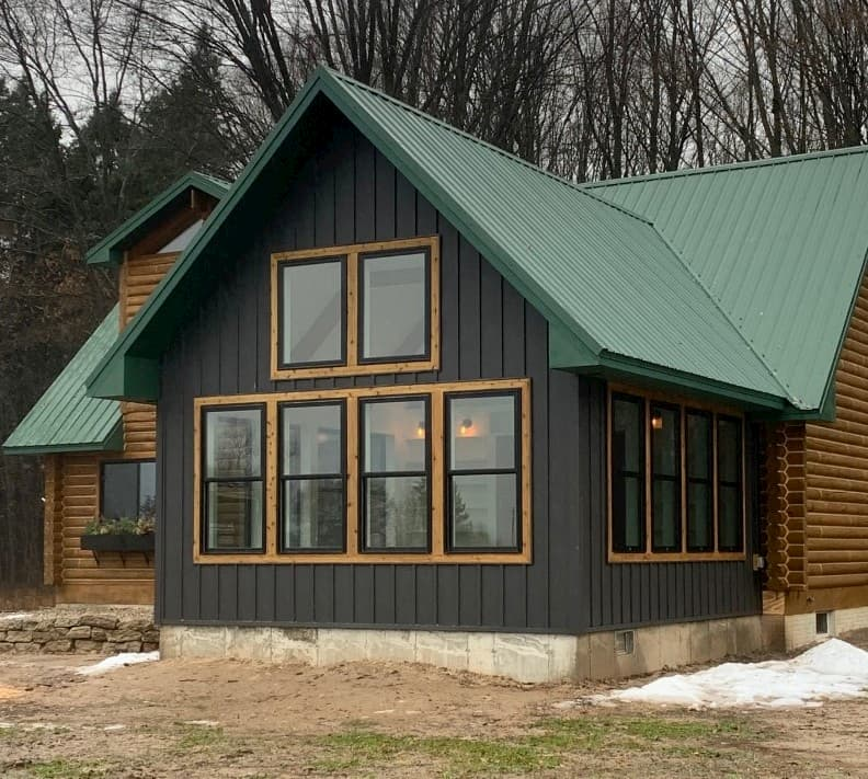 Exterior view of cabin with new black fiberglass windows