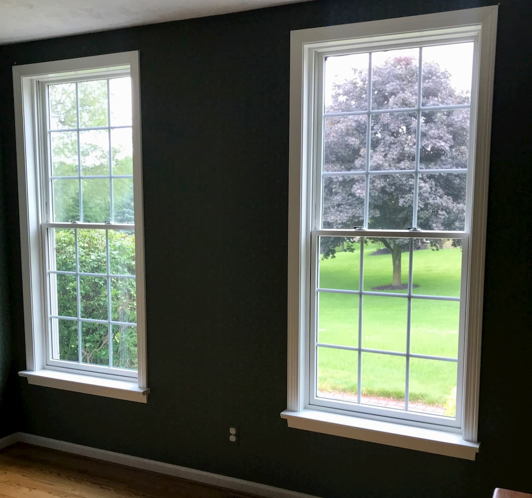 Interior view of two new wood double-hung windows in dining room