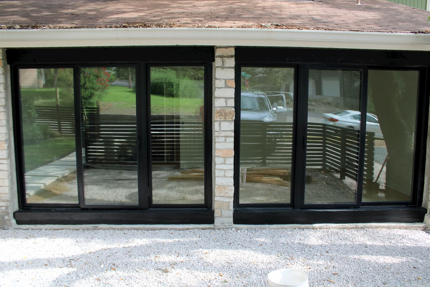 Triple sliding doors installed on garage converted to a music studio