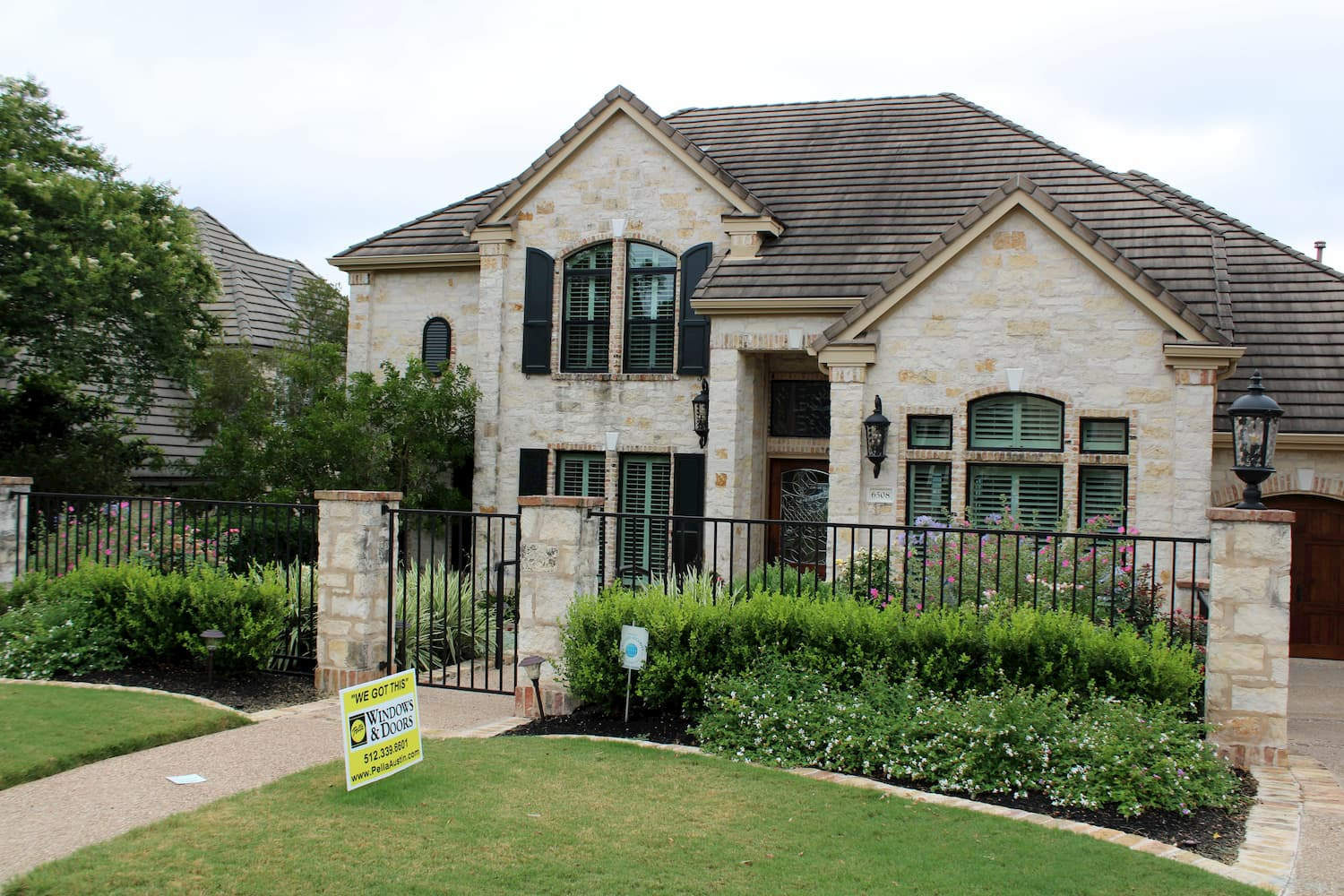 Exterior shot of Austin area home with Pella sign in front yard