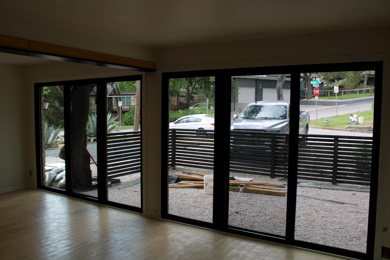 Interior shot of triple sliding glass doors in converted garage