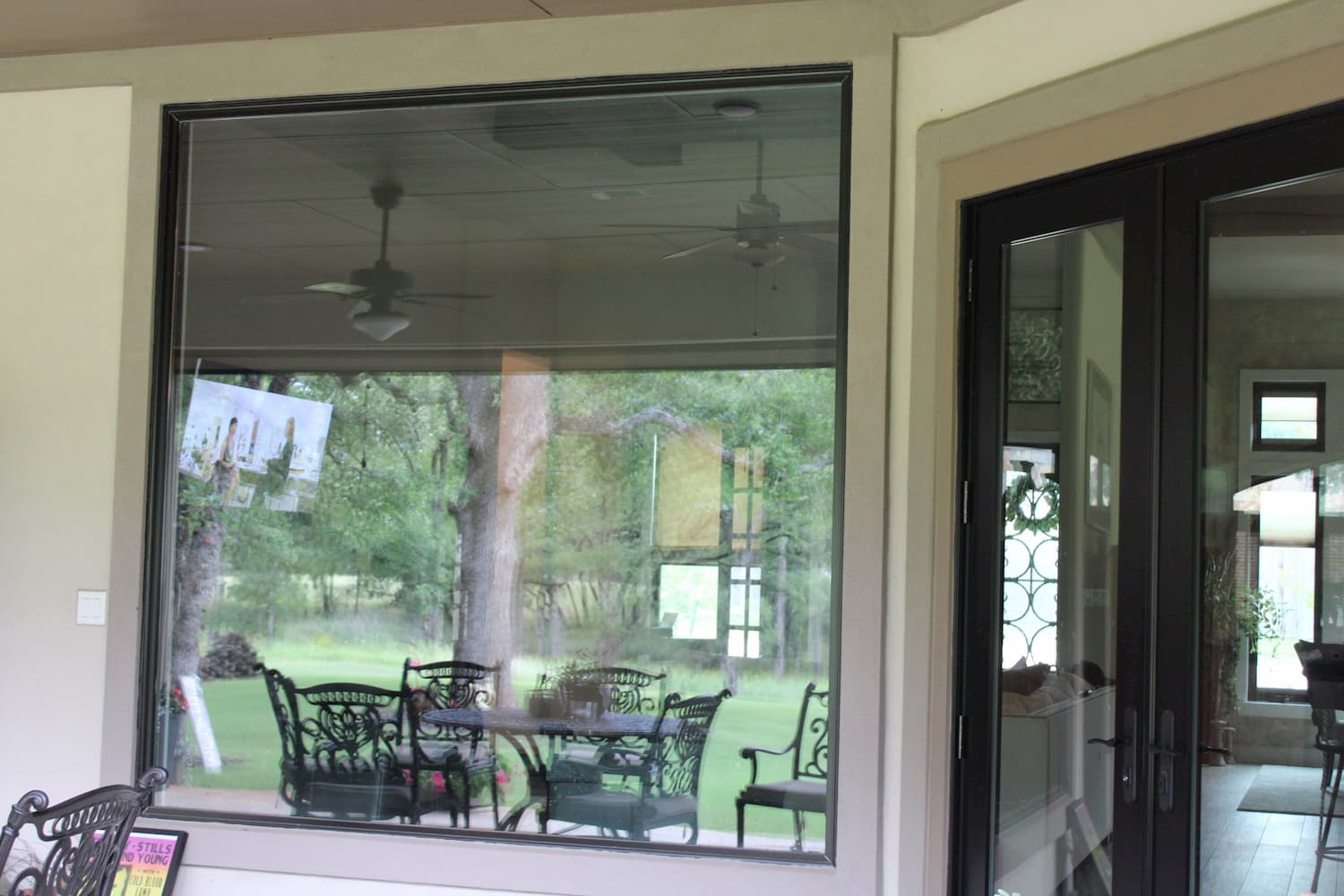 Large rear picture window and double patio doors with glass panels