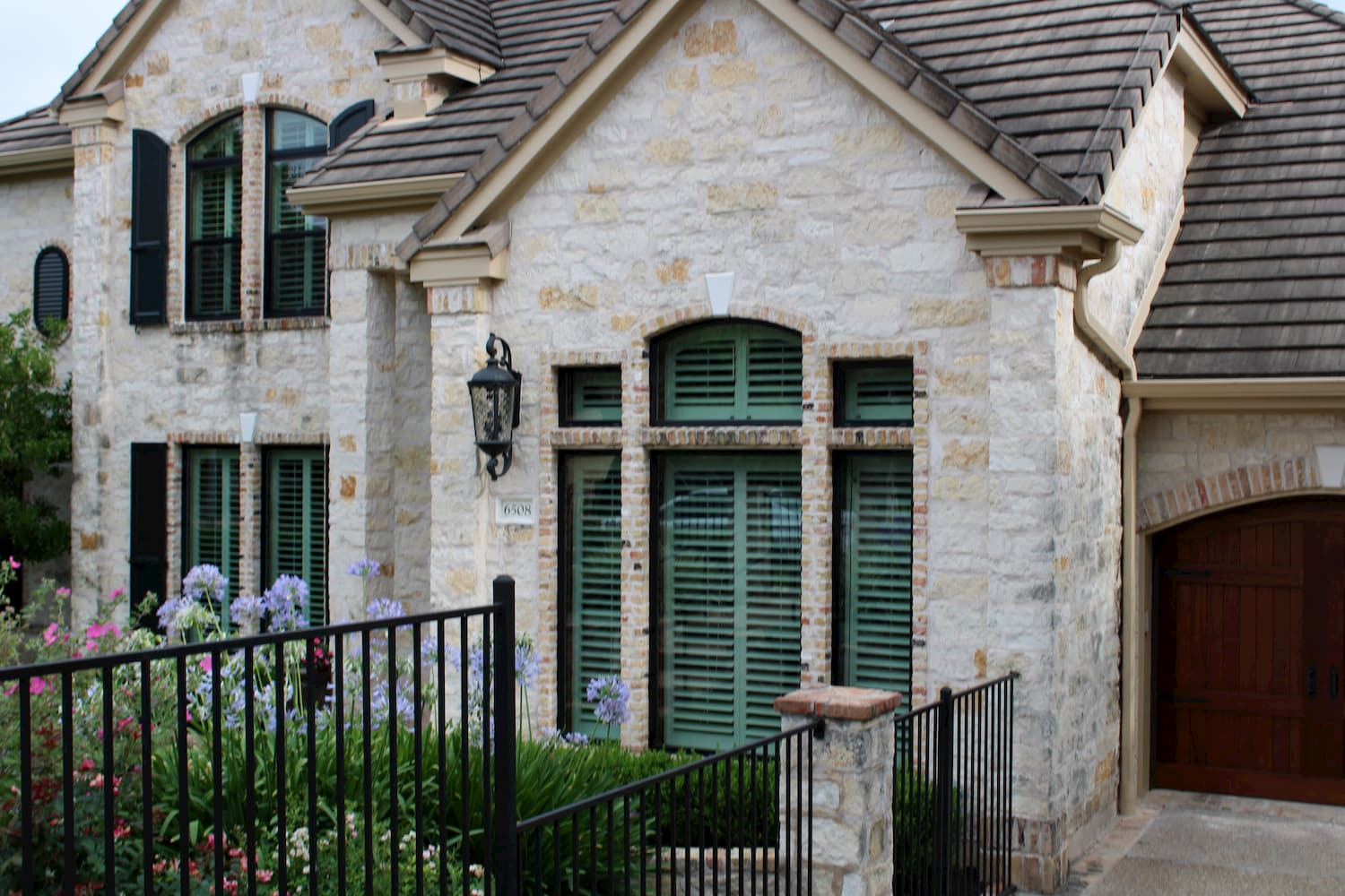 Multiple replacement Pella windows on front exterior of Austin home