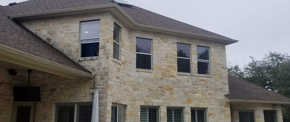 back of austin home with new fiberglass casement, single hung and sliding windows