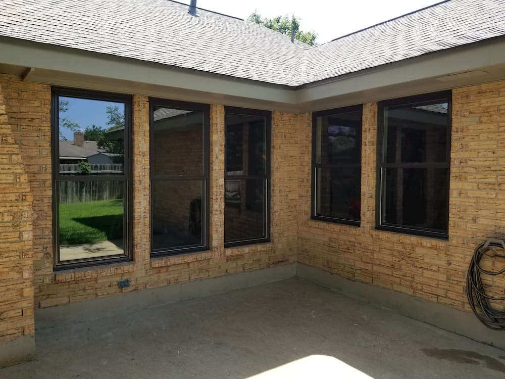 Brick ranch house with new fiberglass and vinyl double-hung windows