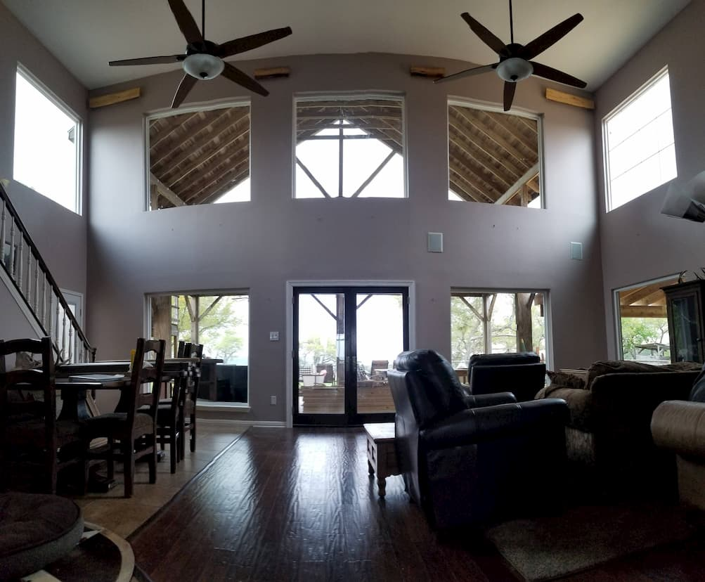 Interior view of living room with picture windows and double hinged patio doors