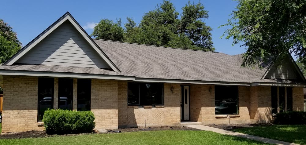 Brick ranch house with new double-hung and fixed windows