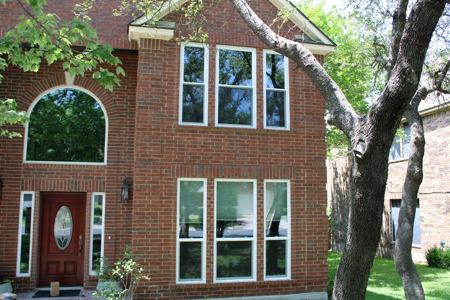 exterior shot of brick cedar park home with replacement pella 250 series windows