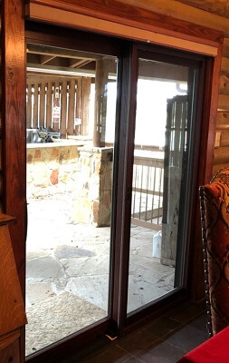 Wood sliding patio doors Build In Blind Inside Of Wimberley Home With New Wood Sliding Patio Door Pella Windows Doors New Sliding Patio Door In Wimberley Log Cabin
