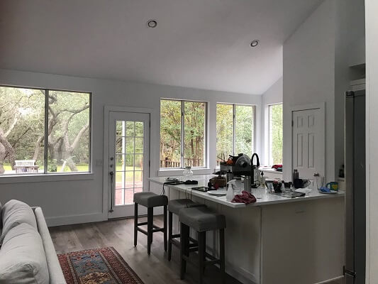 before image of kitchen in austin home with new vinyl casement windows