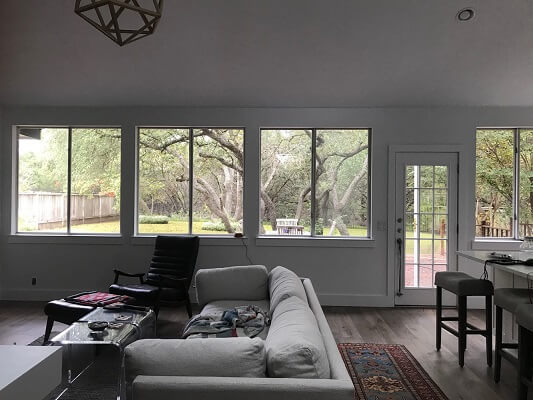 before image of austin home with new vinyl casement windows