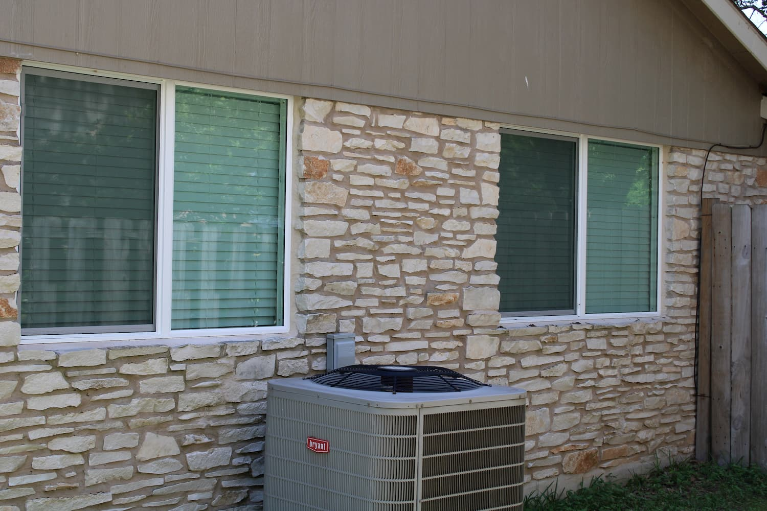 round rock home with a pair of replacement encompass series windows